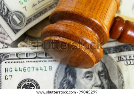 closeup of a gavel on cash, from above - stock photo
