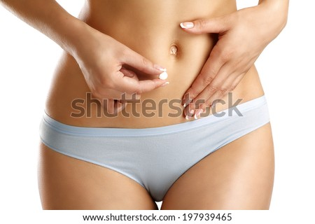 Closeup of a girl feel bellyache symbol on white - stock photo