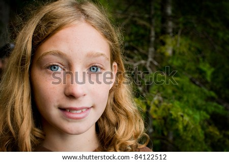 closeup of a girl outdoors in a forest