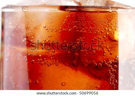 closeup of a glass of cola - stock photo