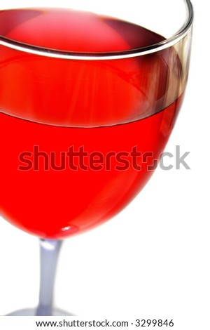 Closeup of a glass of red wine on white background
