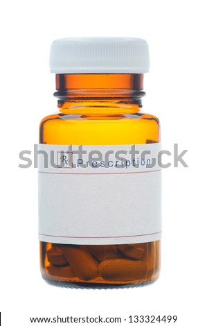 Closeup of a Glass Prescription bottle with a blank label, Brown bottle with pills isolated on white. - stock photo