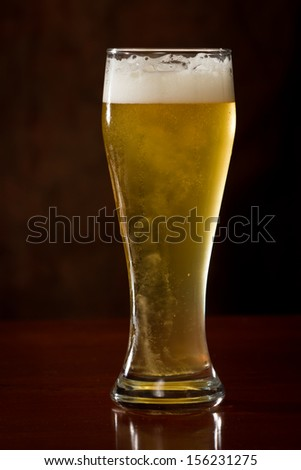 closeup of a golden ale served in a cold pint - stock photo