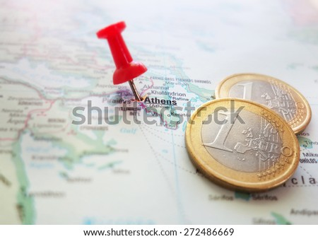 Closeup of a Greece map with Euro coins                                - stock photo
