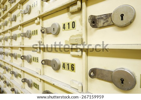 Closeup of a group of cells in an old safe bank. - stock photo