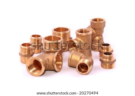 Closeup of a group of copper elbows used in construction - stock photo