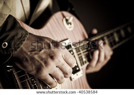 Closeup of a guitar with hand. - stock photo