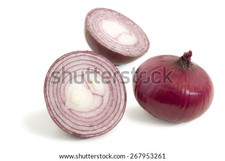 Closeup of a halved and a whole red onions isolated on white background - stock photo