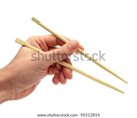 closeup of a hand using chopsticks over white - stock photo