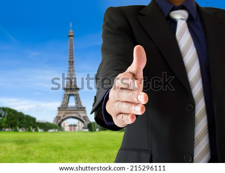 closeup of a handshake in Paris France - stock photo