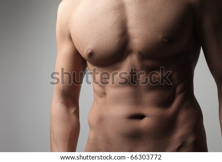 Closeup of a handsome brawny man's chest - stock photo