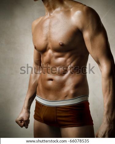 Closeup of a handsome man's torso - stock photo