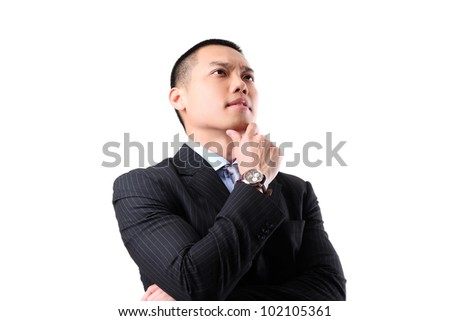 Closeup of a handsome young asian business man thinking on white background - stock photo