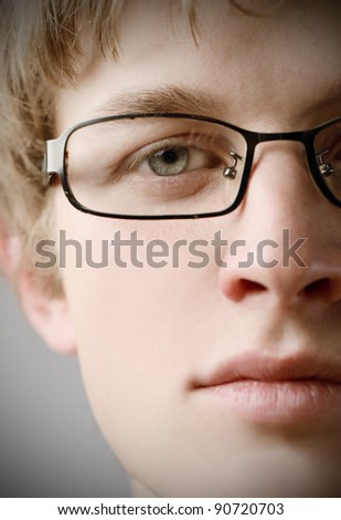 Closeup of a handsome young man wearing eyeglasses - stock photo