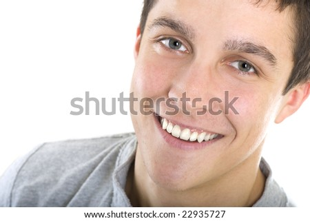 Closeup of a handsome young man with a big smile. - stock photo