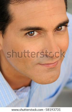 Closeup of a happy casual businessman - stock photo