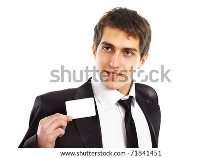 Closeup of a happy male standing by white blank card