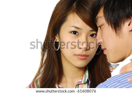 Closeup of a happy woman hugging young man - stock photo