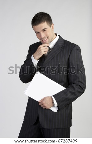 Closeup of a happy young business man - stock photo