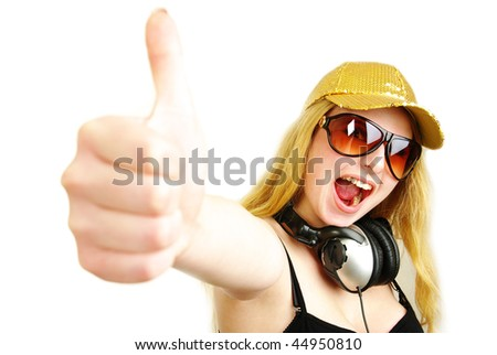 Closeup of a happy young girl with thumb's up sign against isolated white background - stock photo