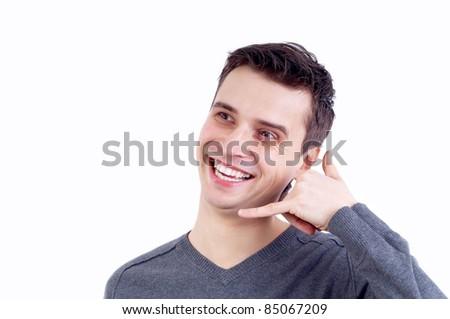 Closeup of a happy young man looking at camera - stock photo