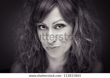 Closeup of a happy young woman  black and white