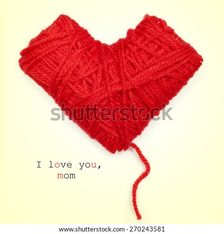 closeup of a heart-shaped coil of red yarn and the text I love you, mom, on a beige background - stock photo