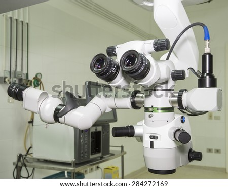 Closeup of a hi-tech microscope examination equipment in hospital operating room - stock photo