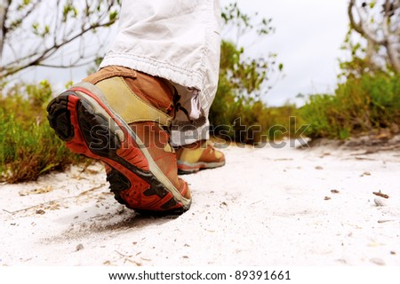 closeup of a hiking boot on a footpath - stock photo