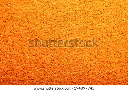 closeup of a household cleaning sponge beige - stock photo
