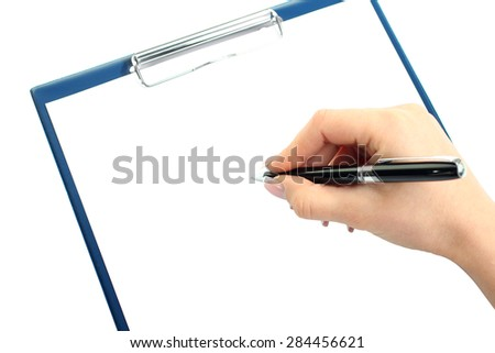 Closeup of a human hand writing with pen on clipboard; copy space