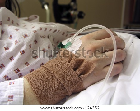 Closeup of a IV/Drip in a patients hand - stock photo