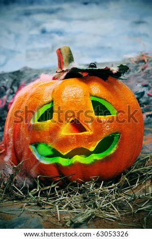 closeup of a jack-o'-lantern in a cemetery for Halloween