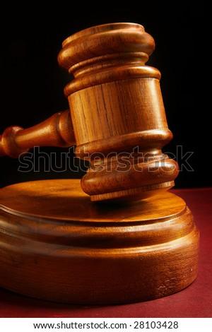 closeup of a judges wooden court gavel - stock photo