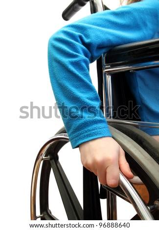 closeup of a kid in a wheelchair - stock photo