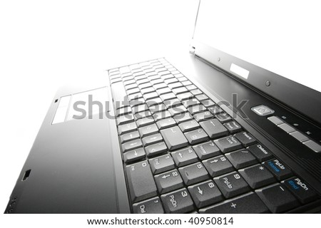 Closeup of a laptop fading into the bright background