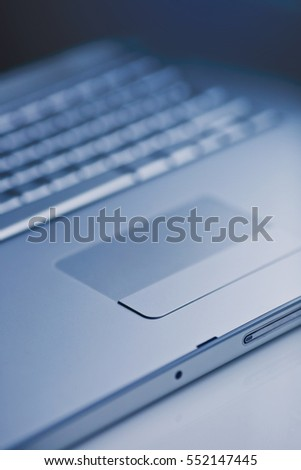 Closeup of a laptop keyboard and trackpad.