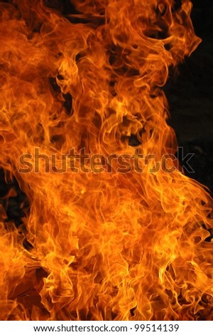 Closeup of a large burn pile with flame detail - stock photo