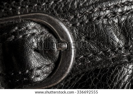 Closeup of  a leather texture with metal buckle - stock photo