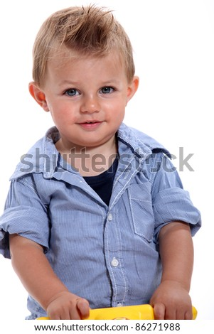 Closeup of a little boy with gelled hair using a walker - stock photo