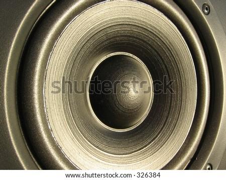 Closeup of a loudspeaker element - stock photo