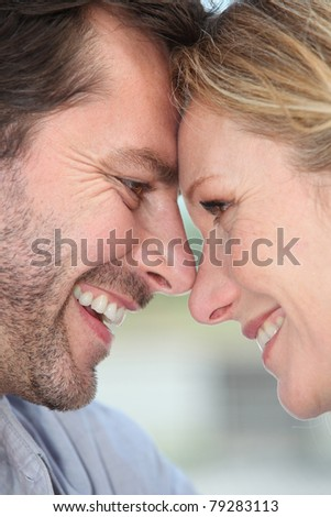 Closeup of a loving couple touching heads
