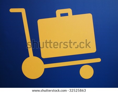 Closeup of a luggage cart airport sign, yellow symbol on dark blue background - stock photo