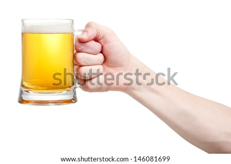 Closeup of a male hand holding up a glass of beer over a white background  - stock photo