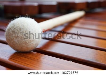 Closeup of a mallet on a wooden marimba - stock photo