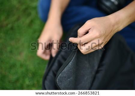 closeup of a man hand holding a bag - stock photo