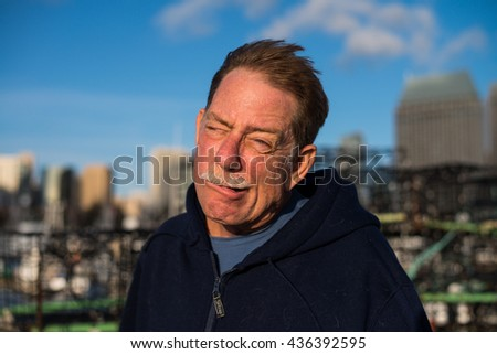 Closeup of a man making a goofy face - stock photo