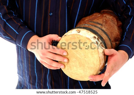 Closeup of a man playing djambe - stock photo