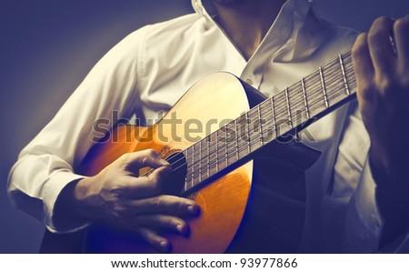 Closeup of a man playing guitar