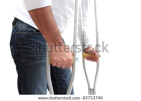 closeup of a man walking with crutches - stock photo